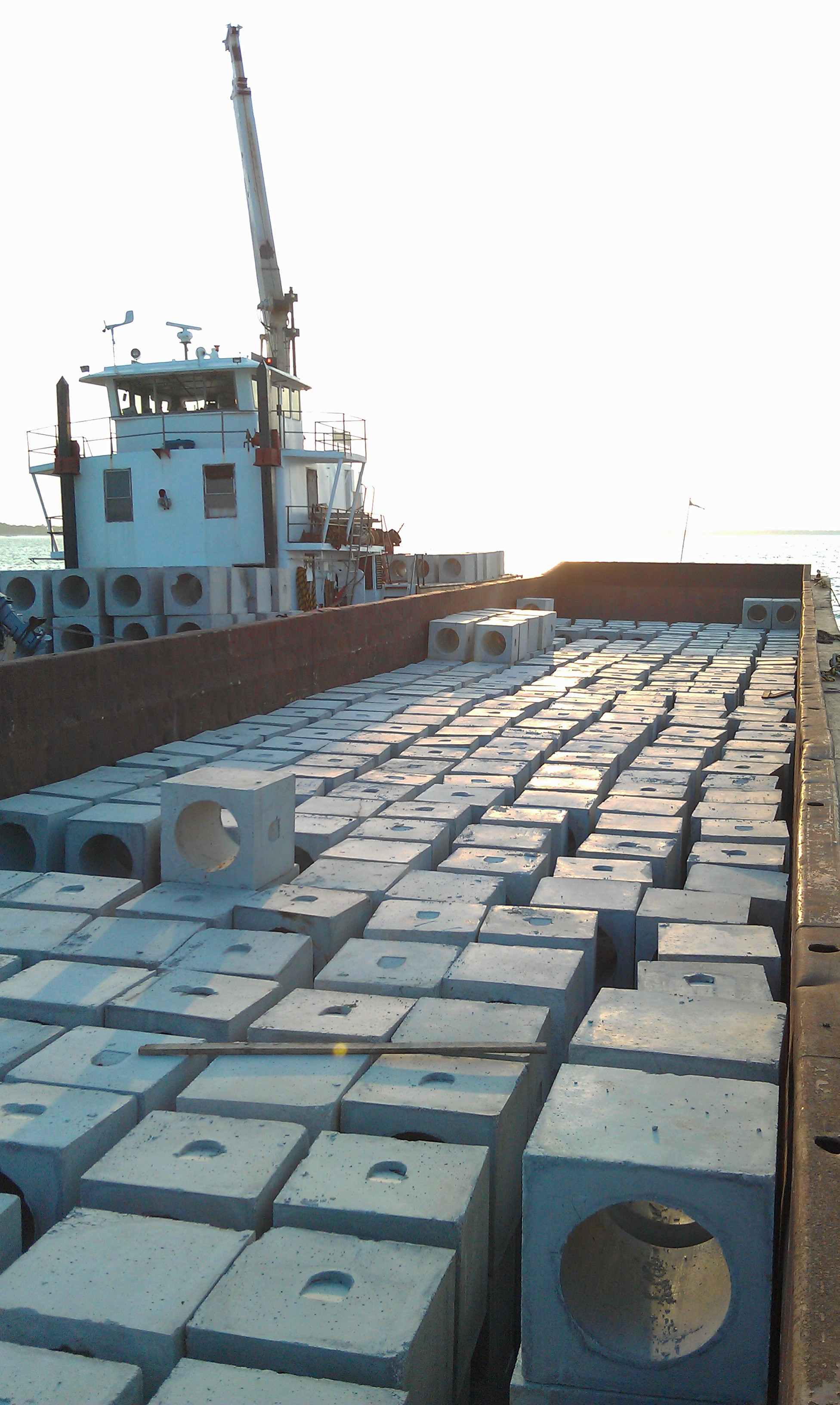 One of two barges loaded with cubes staged near Carabelle, FL to resupply Walter Marine's vessel Maranatha during SFMA reef construction between May 23rd and June 10th, 2011 (Photo Credit: Stewart Walter, Walter Marine)