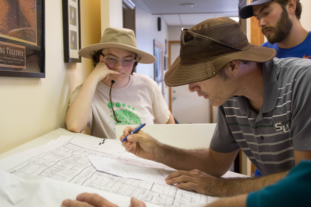 (From left to right) Emily Neiderman, Jason Evans and Adam Carr are mapping out vulnerable areas in Satellite Beach. Photo by Rhiannon Boyer