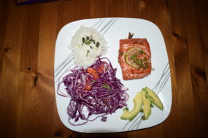 plate with mahi, rice, cabbage, avocado