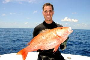 Mike Sipos on boat with large mutton snapper.