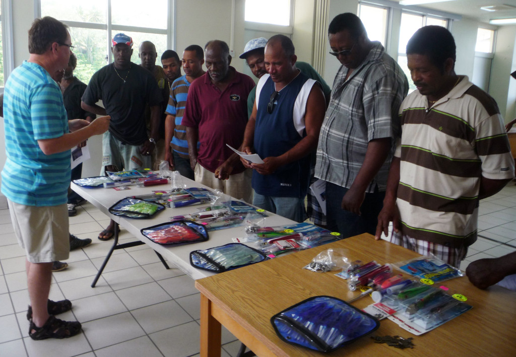 Charles Sidman presents the various artificial lure options to the local fishermen in Dominica.