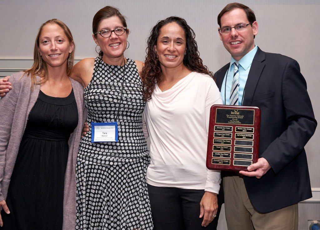The Sea Grant Gulf of Mexico Oil Spill Science Outreach Team receives the National Superior Outreach Programming Award in Portland. Pictured are Chris Hale, left, Tara Skelton, Monica Wilson and Steve Sempier. (Photo by James Dewhirst)