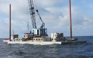 reef materials on barge for deployment