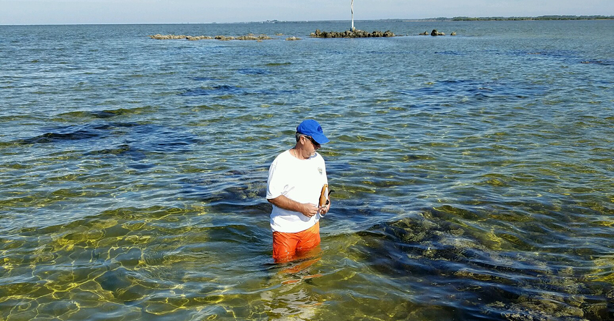 Water sample volunteer wading
